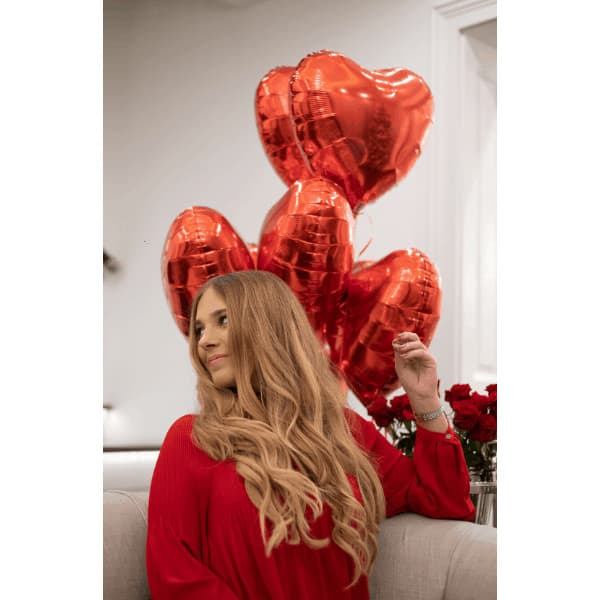 valentines mood with red heart shaped helium balloons