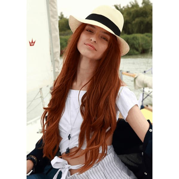 ginger haired girl on a sailboat