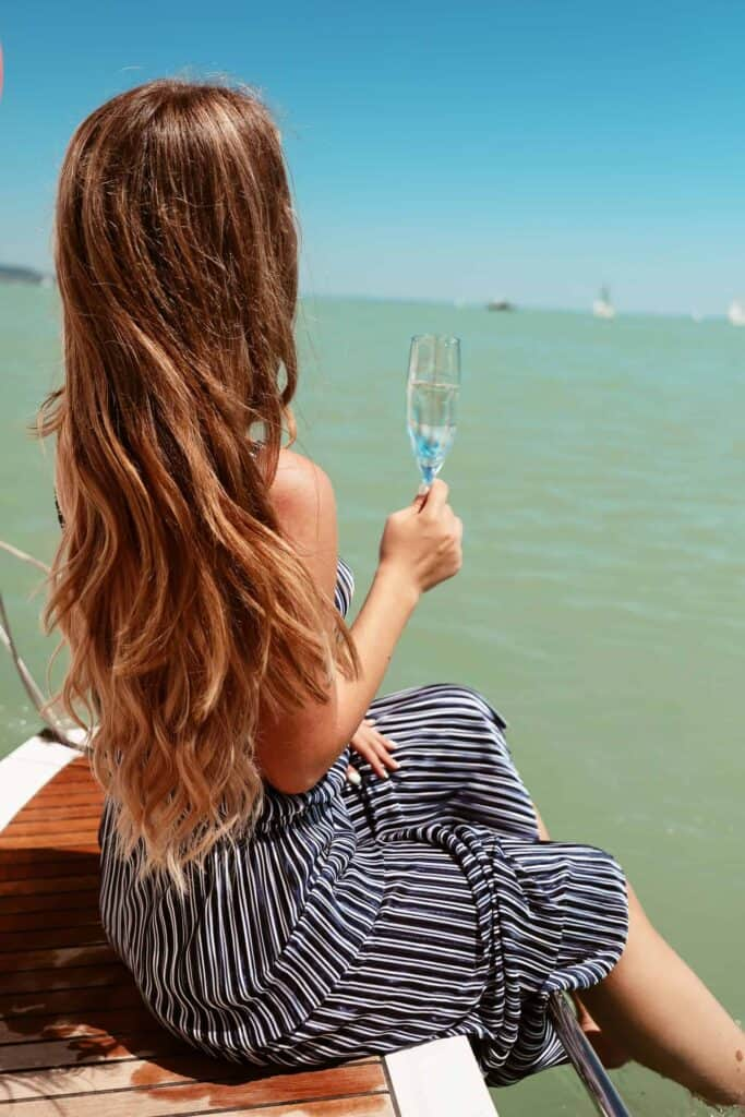 Lake balaton with girls and champagne, fixing summer hair damages