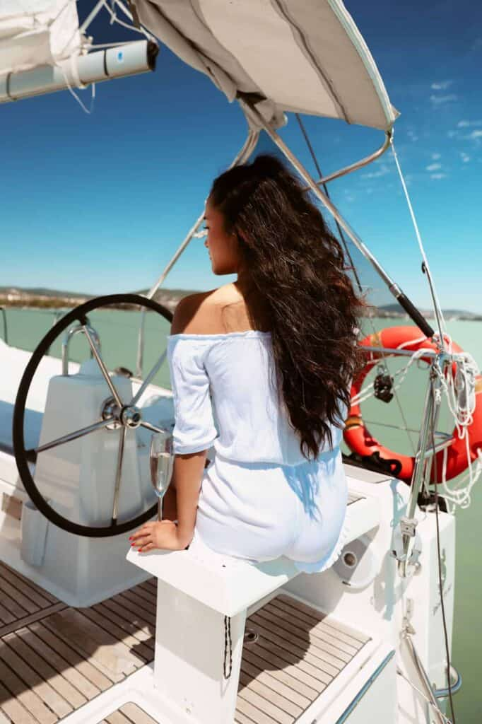 Black haired girl sailing on lake balaton, no damaged hair