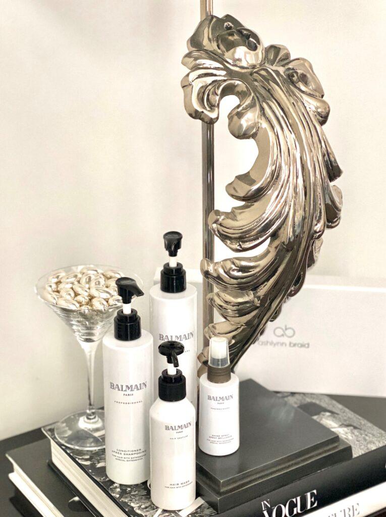 Balmain shampoos and conditioners under designer lamp