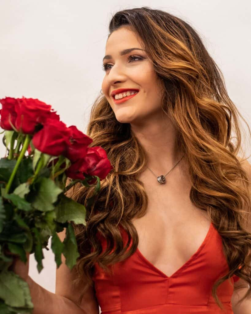 girl holding roses, seductive beauty on valentine's day